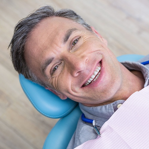 man smiling laying back in exam chair